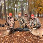 Bill Busbice, Matt Busbice, Lance Ortemond and Ryan Busbice pose with their kills after a successful hunt.