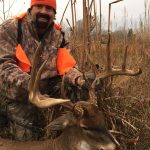 Bill Busbice poses with the largest whitetail he ever killed in Louisiana