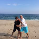 Bill Busbice and his friend Michael Friedman playing on the beach in the Hamptons